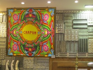 Chapon scarf and chocolate molds on display