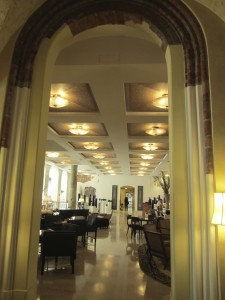 Milano open lobby bar through original cloister archway.
